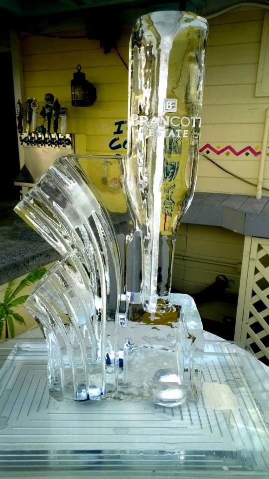 Ice luge with bottle holders on the side