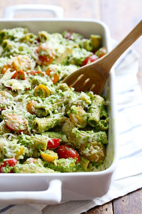 Healthy Baked Pesto Rigatoni is tossed with heirloom tomatoes and a saucy spinach pesto by Pinch of Yum