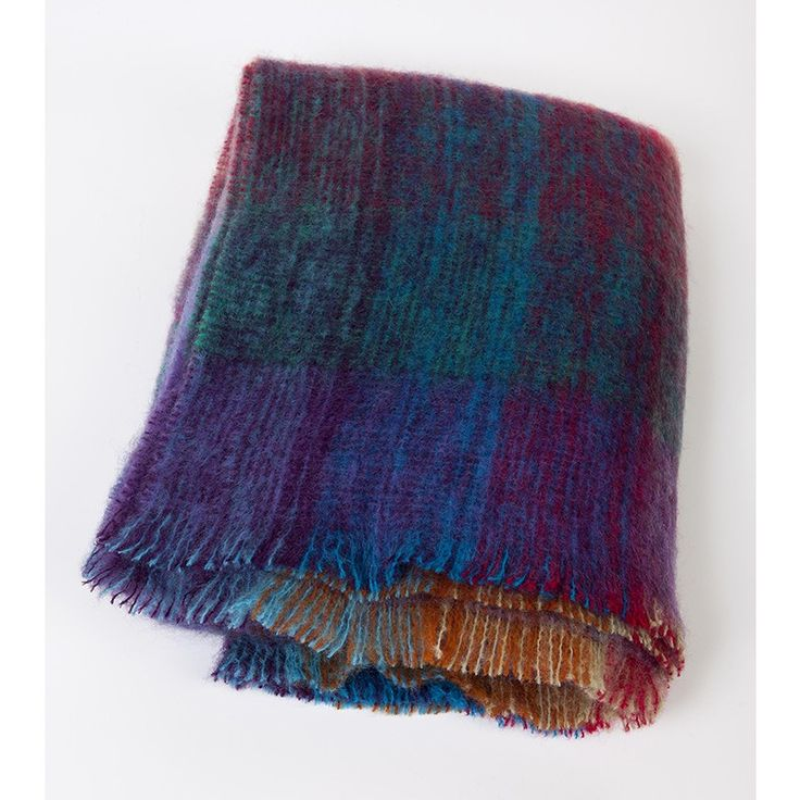 """These large #mohair #throws are woven from the softest mohair yarns in Co. Tipperary.  The fibres trap the air and make them one of our most popular throws.  Mohair retains the heat, making it ideal as a light but exquisitely warm covering.  The colours blend together brilliantly. This large size is ideal for the end of a bed.  137 x 182 cms (54"""" x 72"""")."""