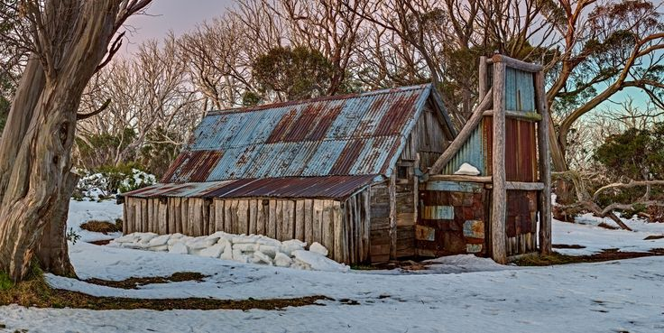 An early autumn snowfall blankets Wallace's Hut, in the Australian Alps.