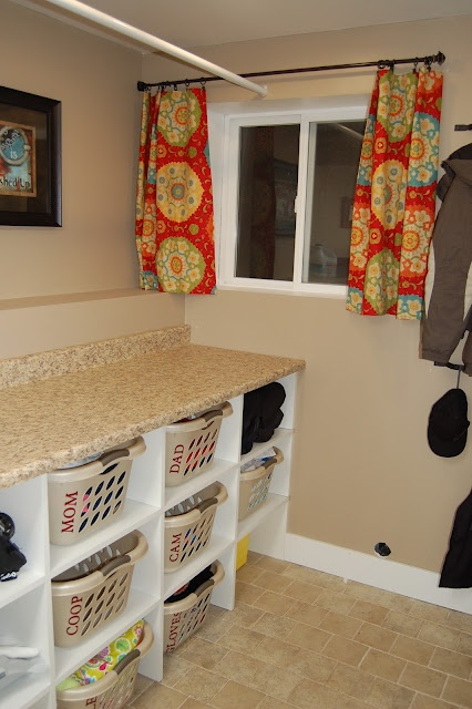 laundry area with baskets for each person and drying rod and folding area.  Two baskets for each person...one for dirty laundry in their room, and one to put clean laundry when it's finished.