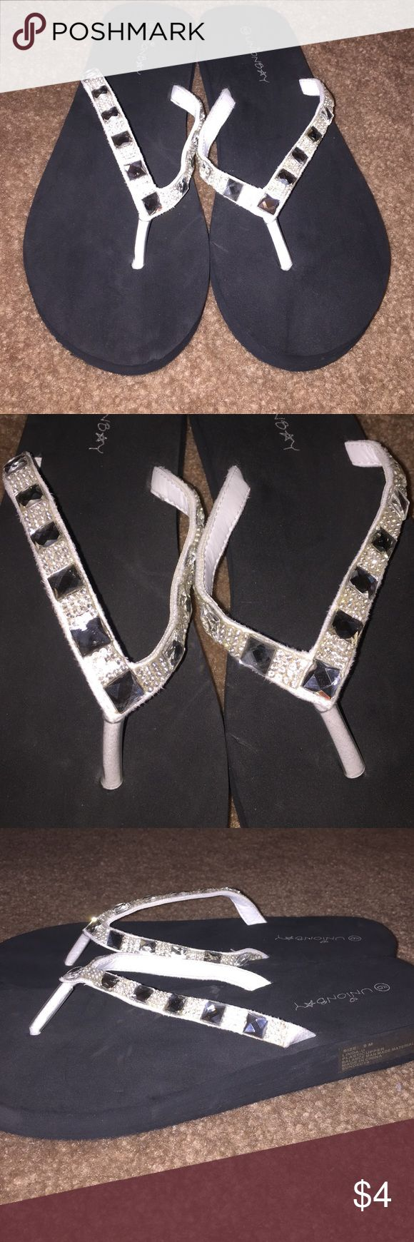White Bling flip flops! Super comfy Sandals! They have white straps with bling rhinestones! The sole is made of foam so they are soft! Brand New, never wore them! UNIONBAY Shoes Sandals