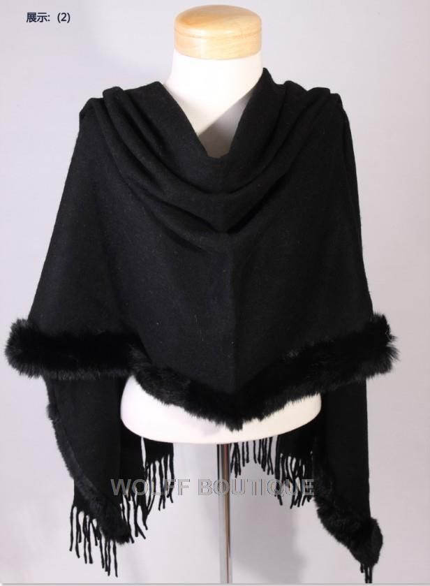 Cashmere Wool Black Shawl / Stole edged in black rabbit fur along one side and tassels the other.  Can be worn in different ways.  Only one left available. One Size. Contact:  wolffboutiquefashion@gmail.com