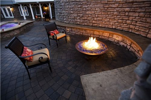 fire pit with built in seating against wall