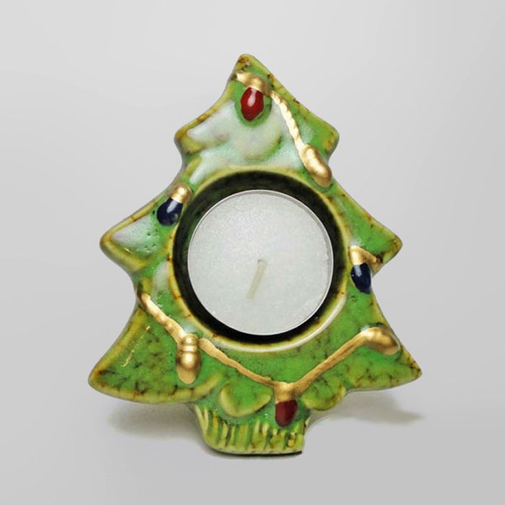 Christmas Tree Ceramic Tealight Candle Holder - CH251 - Christmas tree tealight candle holder. Ceramic with Christmas light design. Rough bottom keeps the candle holder from sliding. 3-1/2L x 1W x 4-1/4H Nice for all your holiday parties. FOR SALE