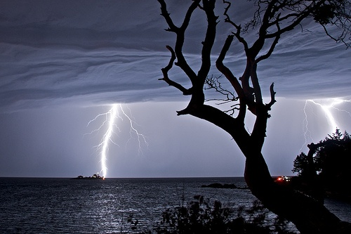 More lightning and storm clouds, from Berry Point on Gabriola Island by GabriolaBill, via Flickr