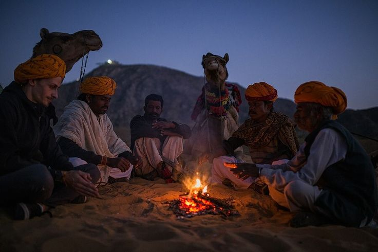 Moments between shooting and listening to these Pushkar camel men play the sitar around the fire. Rajasthan, India.