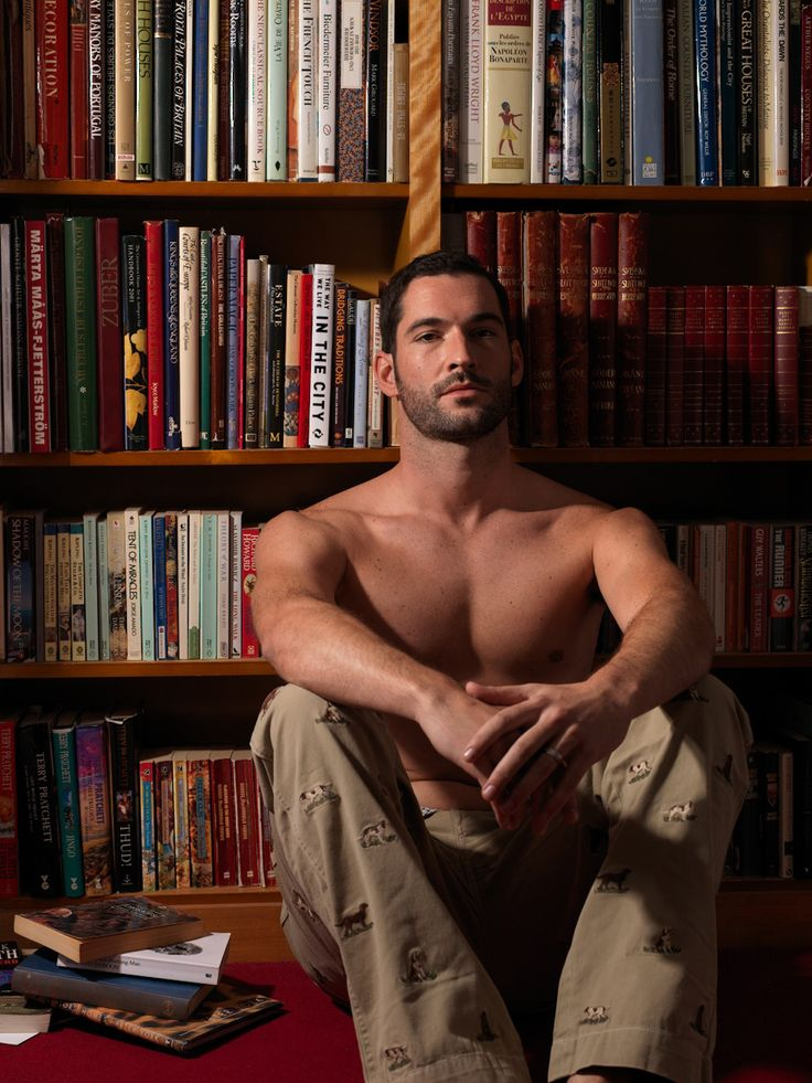 Actor Tom Ellis with books and without a shirt. This is a good thing.  And, well, he might not be reading but he's near books, so I think that counts for this category!