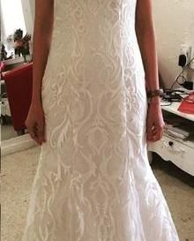 Amie Boughen created this breathtaking dress using our Karma Ivory Embroidered Lace