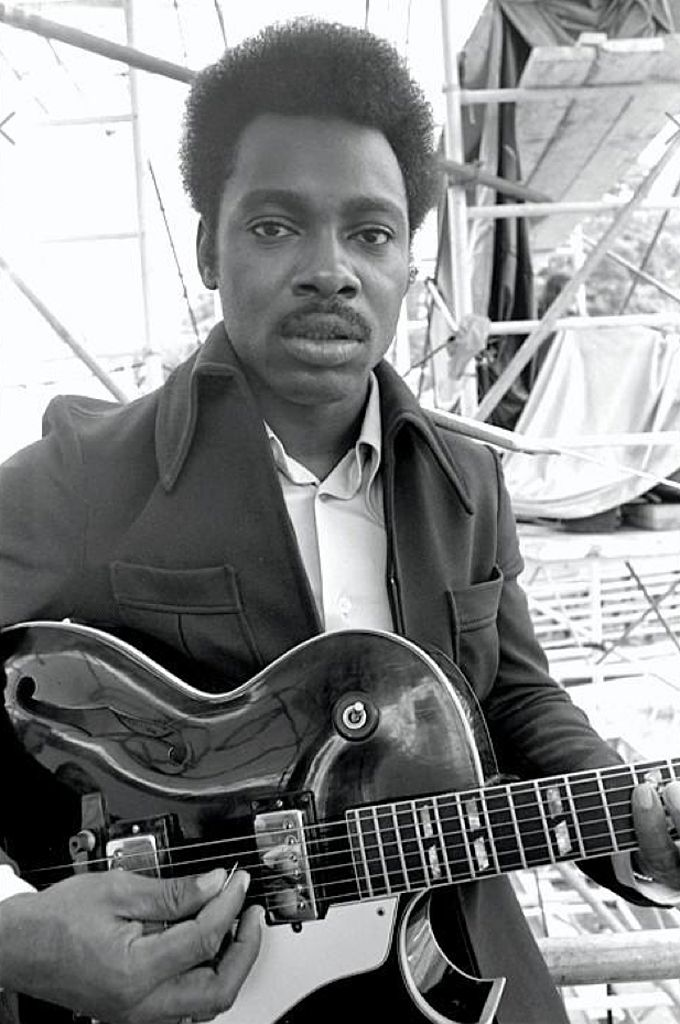 Great old black and white pic of George Benson with his guitar.  He's a very young man here.