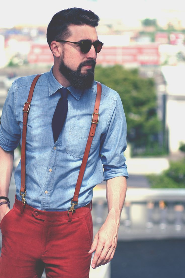 Old fashioned leather suspender, colorful red pants, and a well trimmed bear