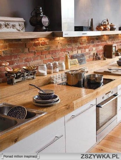 Love the exposes brick splash back. The deep worktop is a great idea as well.