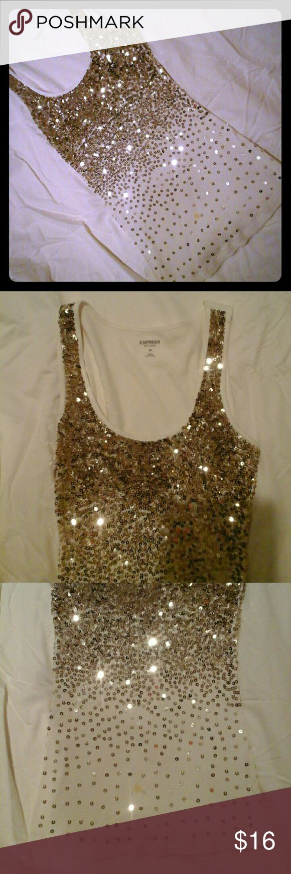 Sparkly Last pic is back of ribbed tank. Sequins on front. Tank is off white with gold sequins. Small spot will come out with gentle spot remover. Pretty sure it is just makeup Express Tops