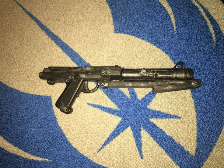 This is a custom battle droid blaster from  episode 1. I made from an old game I played as a kid. I cut off the wire and painted it. It is movie accurate, I just made it to look like a weathered blaster from the clone wars.