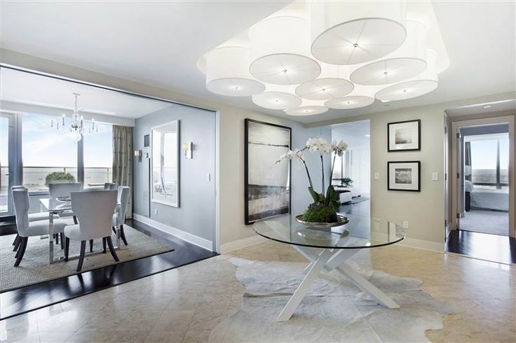 This one-of-a-kind Luxury Duplex Penthouse Residence, located on the top two levels, of the famed Ritz-Carlton in Battery Park City, offers all the white-glove amenities of a five-star hotel, including 24-hour concierge, room service, fitness center and spa, housekeeping and valet parking.  This sun-drenched four-bedroom, five-full-bath home features panoramic sweeping views of New York Harbor, the Statue of Liberty, and beyond.  Walls of floor-to-ceiling glass windows maximize the dramatic…