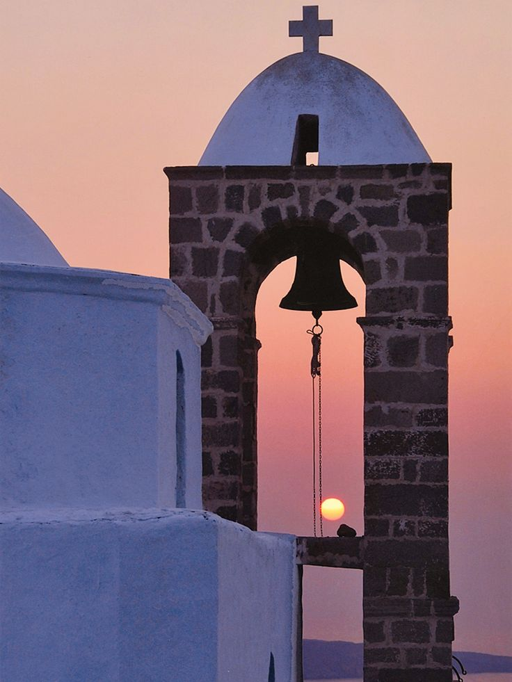 Church Steeple at Sunset in Oia, Santorini Island, Greece www.oiamansion.com