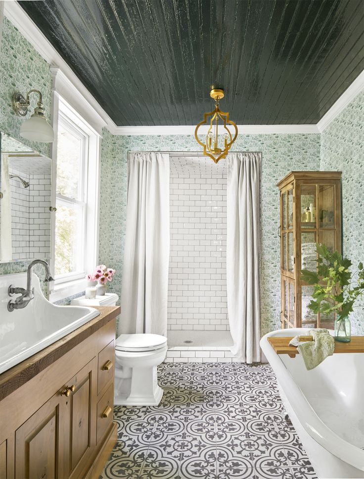 Like the dark glossy beadboard with the bright airy room.  Also like the floor tile against patterned walls