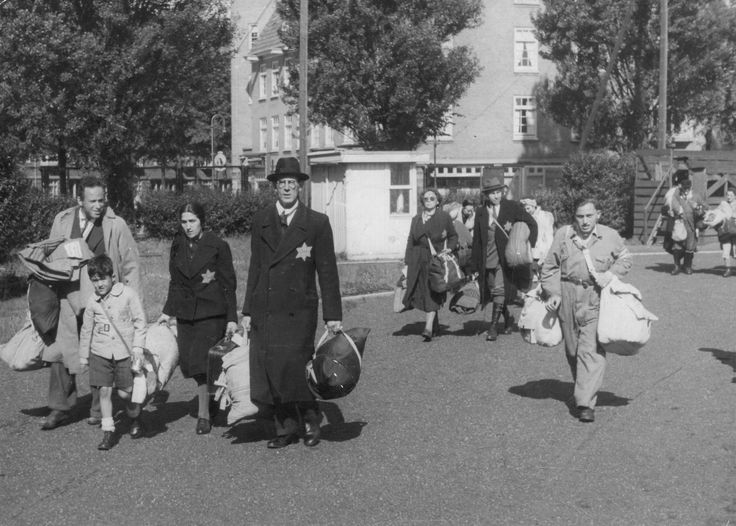 A Jewish family in the sports complex on the Olympiaplein in Amsterdam, awaiting deportation to Westerbork concentration camp. June 20th 1943.