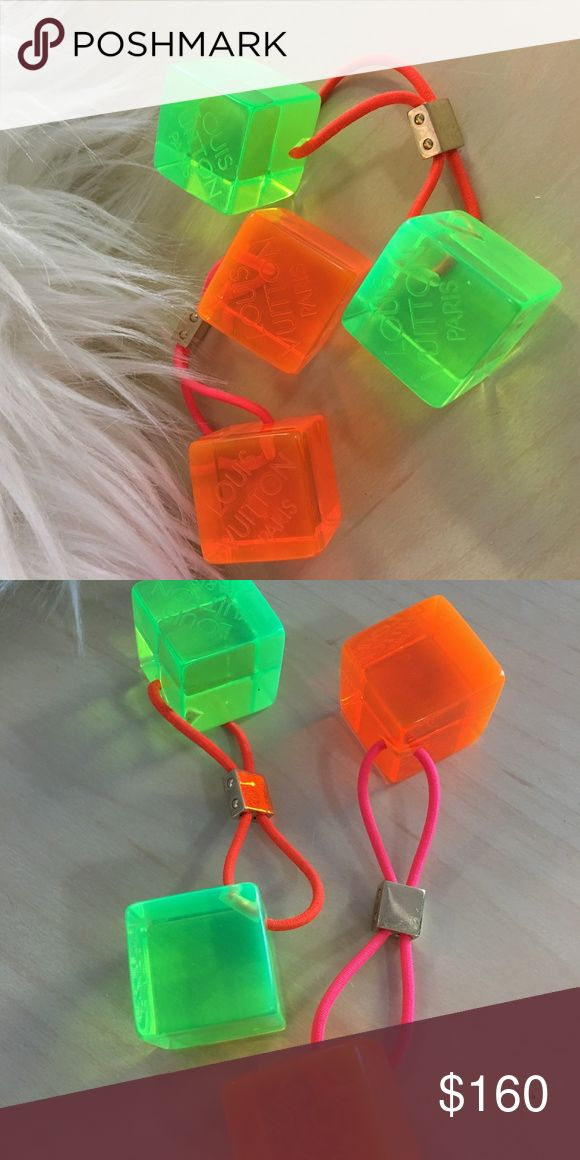 louis vuitton limited edition lucite hair cubes 2 pairs (one orange and one green) of AUTHENTIC Louis Vuitton hair cubes (ponytail holders) in pre-owned but not used condition. Were kept as collectibles but never worn. There are minor scratches on the metal from handling, otherwise, they are in excellent condition and come with one Louis Vuitton box, one LV protective dust-cover and one LV dust/polishing cloth. Makes a great conversation piece or just a fun way to dress up a ponytail. Louis…