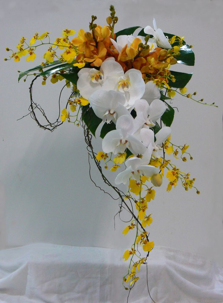 Different types of orchids used in a modern style bouquet