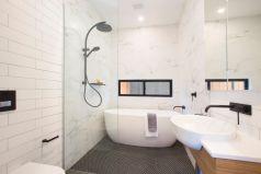 Chic designer bathrooms, under floor heating, black tapwear, bath