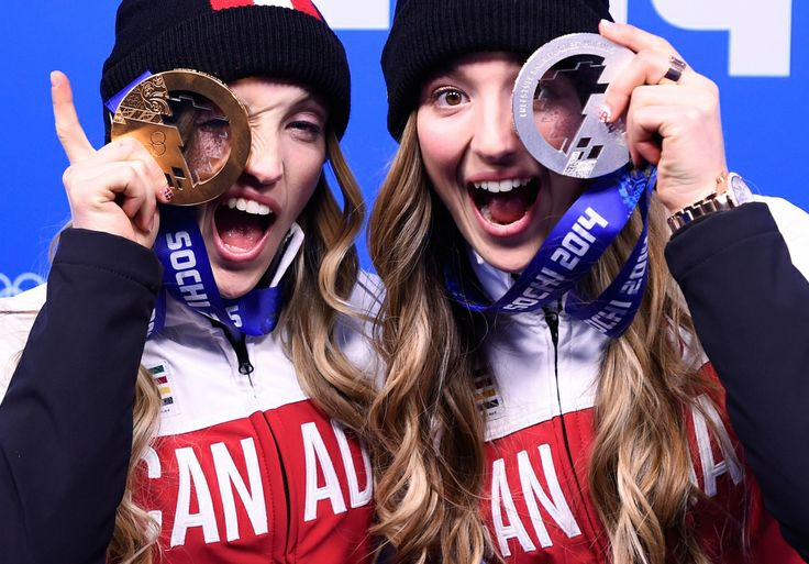 Canada at Sochi Games - Day 2 of Competition |- CTV News at Sochi 2014  ~~ Canadian sisters Justine Dufour-Lapointe, left, and Chloe Dufour-Lapointe show off their gold and silver medals from the women's freestyle moguls after the medal ceremony in Sochi, February 9, 2014.