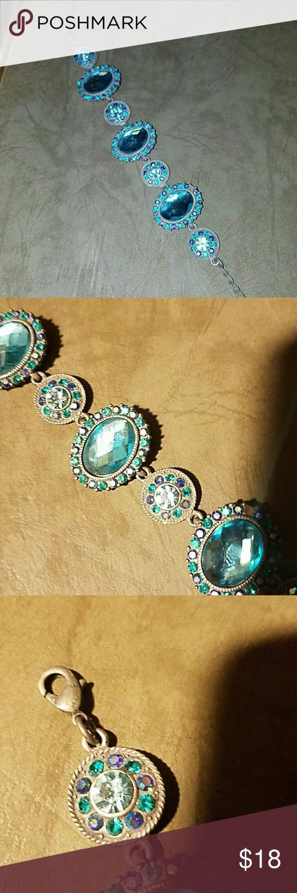 Tunisian Aqua , purple & green bracelet. A STUNNER Tunisian Aqua , purple & green bracelet. A STUNNER. Lobster claw closure, picture 3. Jewelry Bracelets