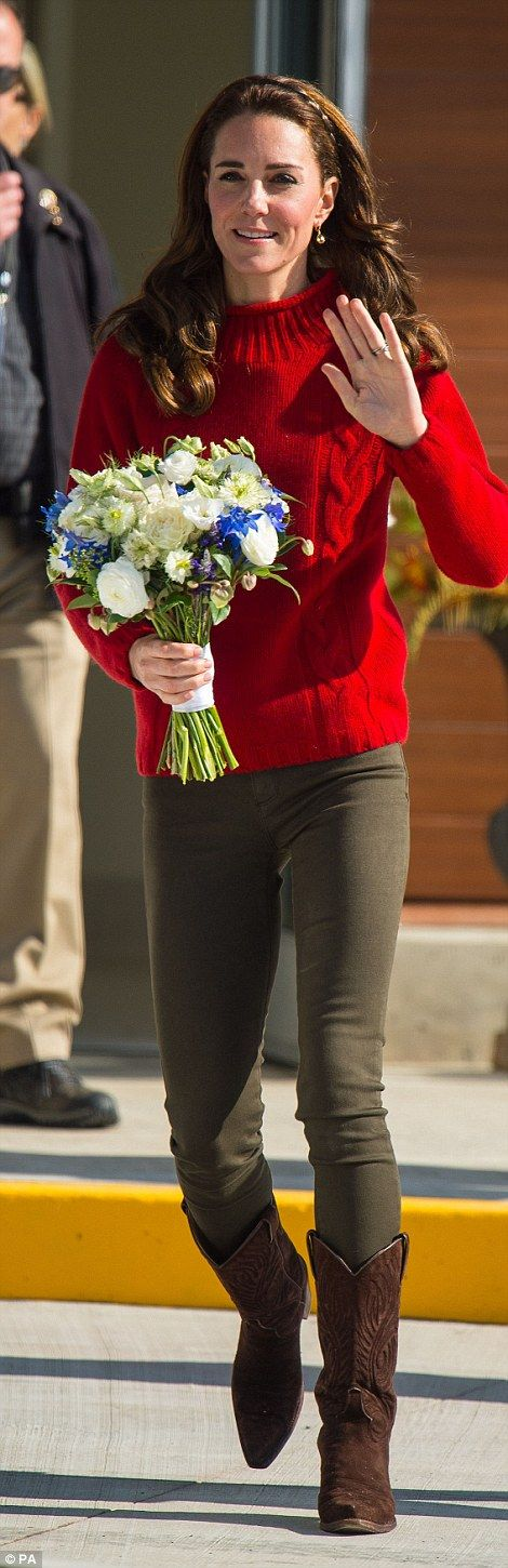 The Duchess even managed a swift clothing change later in the day, donning a pillarbox red woolen jumper