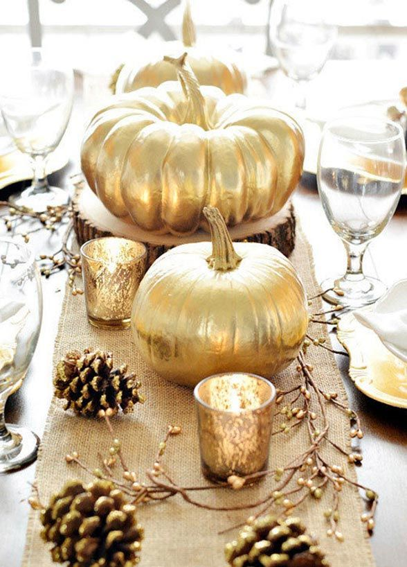 We are obsessed with pumpkin centerpieces. Varying sizes of gilded pumpkins give off some serious Cinderella vibes.