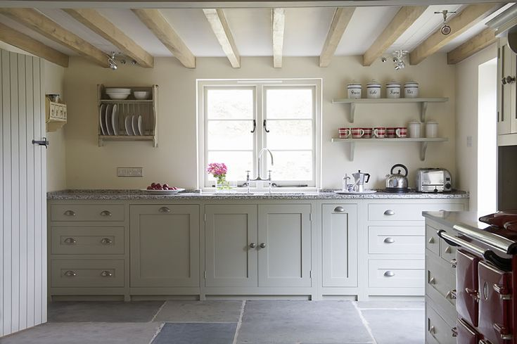 Wooden kitchen cabinets in this country cottage look fabulous painted in Farrow & Ball's Mizzle, and paired with slate flagstones. http://www.deterra-kitchens.co.uk/