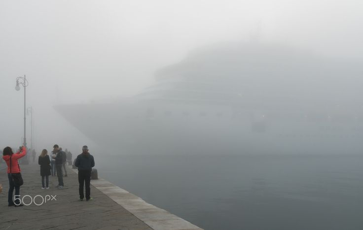 My little boat in Trieste - A huge cruiser, named Costa Deliziosa in the port of Trieste, Italy, next to Molo Audace. There was so foggy that it can't be seen from more far distance at all.
