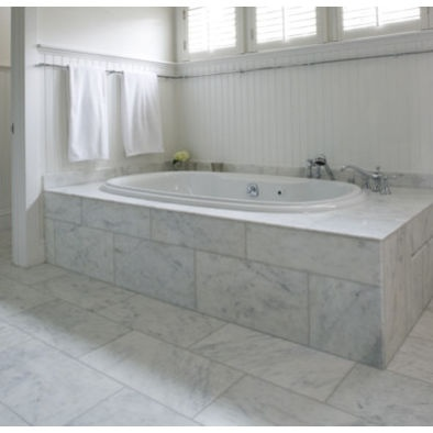 Spaces white carrera marble tile black floor design - Is marble tile good for bathroom ...