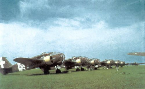 Line-up of recce plans Caproni Ca.311 of 128th Squadriglia, 61st Gruppo Autonomo Osservazione Aerea (Autonomous Air Observation Group) likely on a Balkan airfield, prior of unit's transfer on Eastern front, spring 1941.