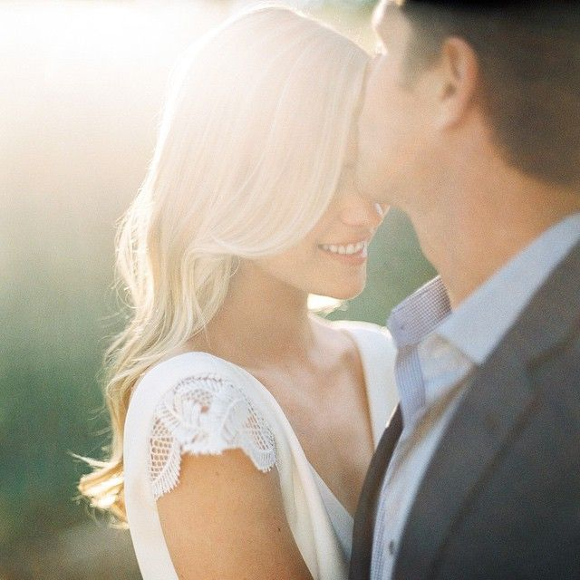 Prettiest blonde bride with her groom
