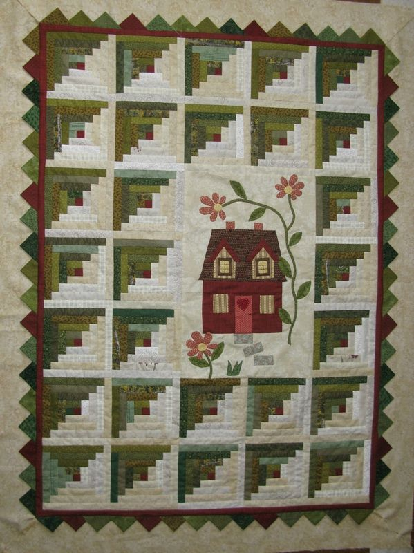 """Nice log cabin block quilt  sandi: I appear to have a """"thing"""" for house quilts. This one, with its unusual setting and lovely log cabin colourways, goes right into my top twenty-five."""