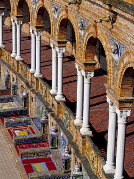 As different view of Plaza de España in Seville, from the balcony. The red tiles mark the area for each province in Spain - the yellow is the province's map.