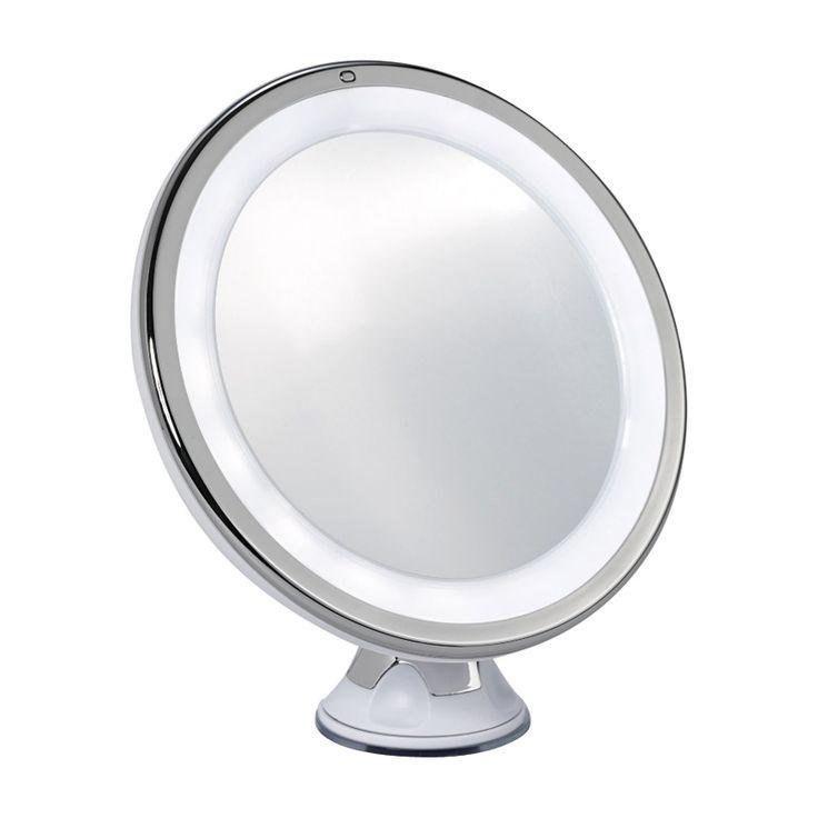En rund och ensidig sminkspegel som står på en liten pedistal och sminkspegeln har en sugpropp för väggmontering. Sminkspegelns belysningär batteridriven
