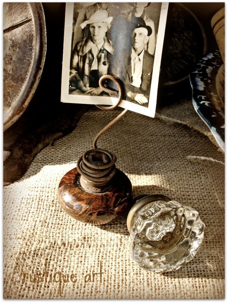 repurposed door knob picture holder i could do this with all of those nifty doorknobs antique