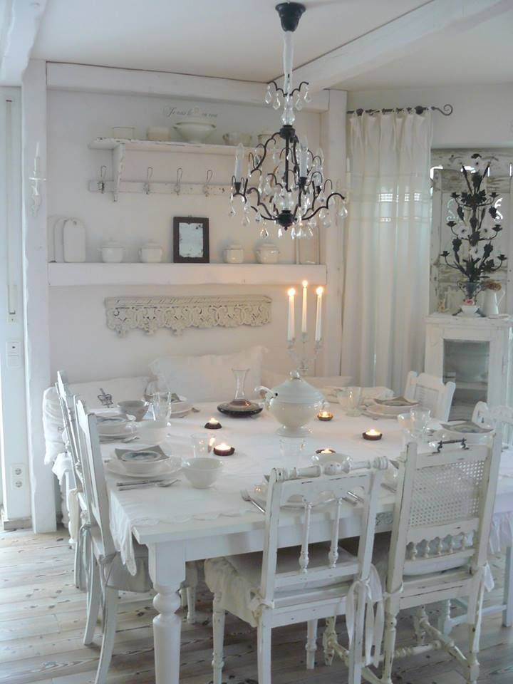 White romantic shabby chic square dining room with mixed vintage chairs