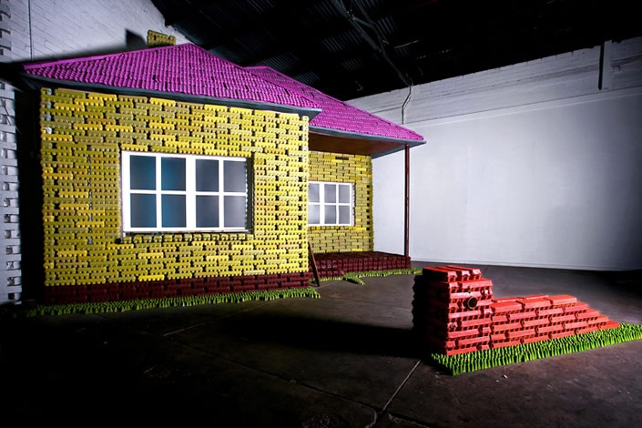 The first 'Eggo' exhibition installation. Based on the painting by Howard Arkley – Family Home, Suburban Exterior 1993, the house was built out of recycled egg cartons and egg trays using the materials in a similar fashion to Lego.