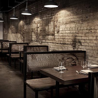 restaurant's booths using  reclaimed wood that they branded with the restaurant's signature 'G.'