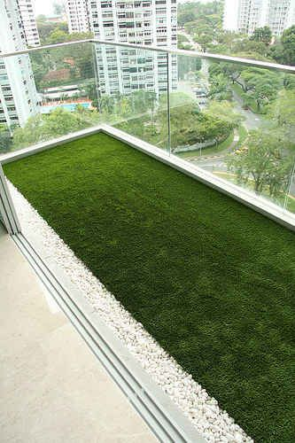 Turn your balcony into a yard with astroturf. | 42 Ingeniously Easy Ways To Hide The Ugly Stuff In Your Home