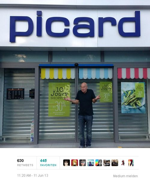 Captain Jean Luc Picard of the starship Enterprise in Star Trek Next Generation aka Sir Patrick Stewart standing in front of store called Picard.