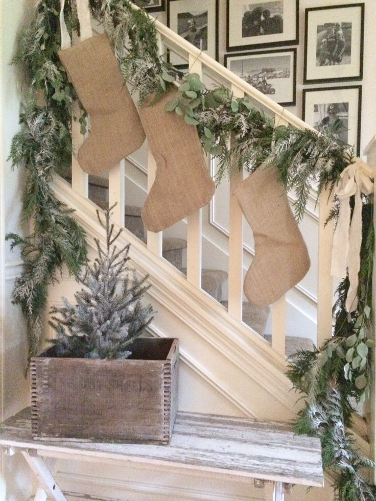 25 unique stairway christmas decorating ideas on for Hanging garland on staircase
