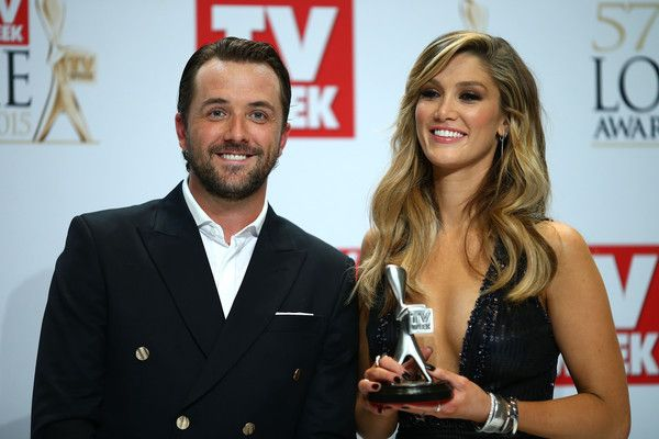 Delta Goodrem Photos Photos - Darren McMullen and Delta Goodrem poses in the awards room after winning a Logie for Most Outstanding Light Entertainment Program at the 57th Annual Logie Awards at Crown Palladium on May 3, 2015 in Melbourne, Australia. - 2015 Logie Awards - Awards Room