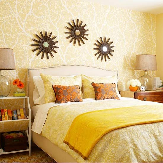 Patterned wallpaper featured on just one wall of this bedroom creates a dramatic focal point.