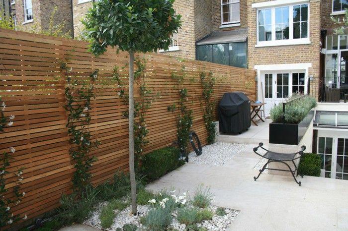 Garden design ideas garden fence climbers plants pebbles