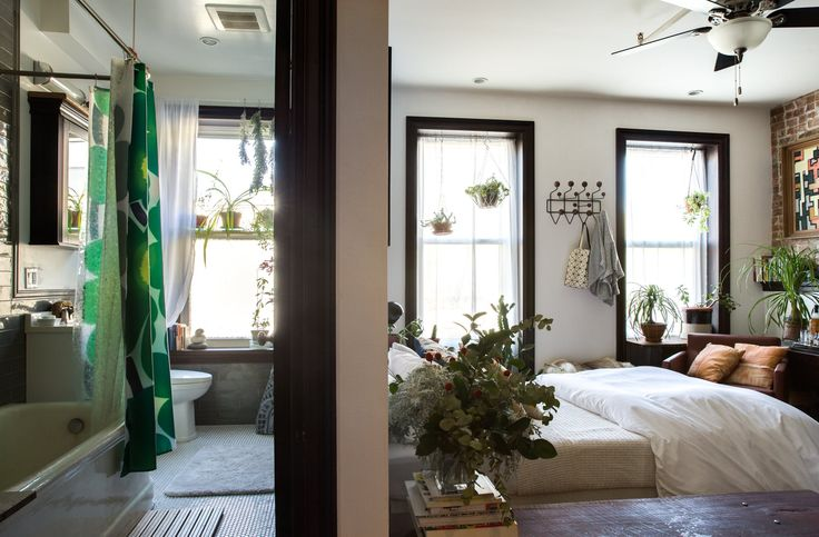 From the front door, visitors can see the one divide that exists in the house. (Would love a better look at that bathroom!)