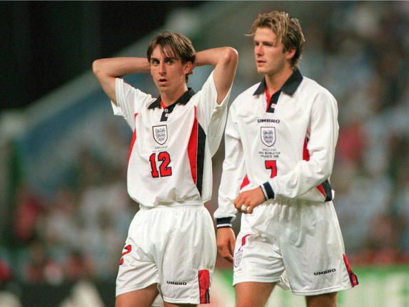 World Cup 1998 Finals, St. Etienne, France. 30th June, 1998. England 2 v Argentina 2 (Argentina win 4-3 on penalties). England's Gary Neville looks over as David Beckham leaves the field after being sent off for kicking out at Diego Simeone