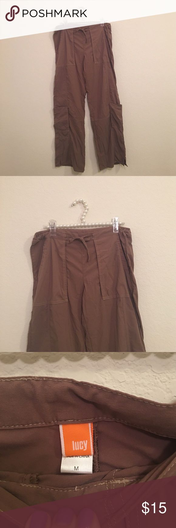 Women's Lucy Cargo Trouser Size Medium Lucy trousers! Great condition! Super comfy, draw string at waist, Cargo pockets on the side. Size Medium. Lucy Pants Trousers